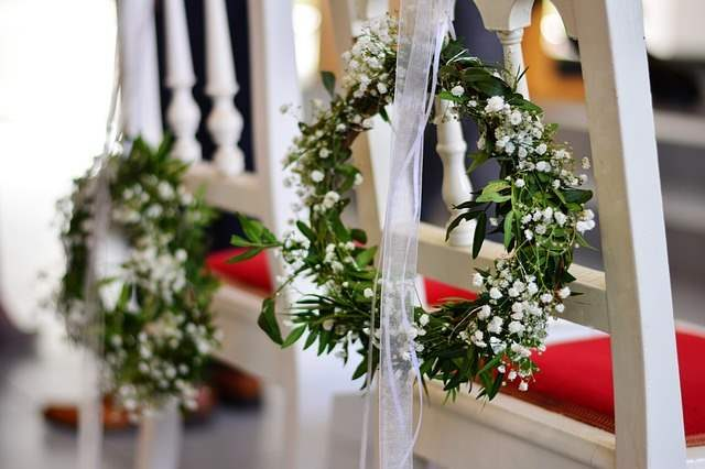Wreaths hung on chairs